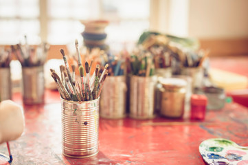 Boy painting in studio