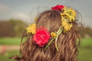 Head of little girl wearing flowers, back view