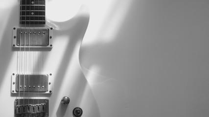 white guitar . white background