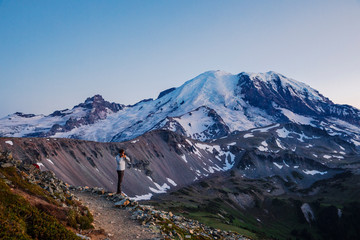 A Man Taking Pictures of Mountain Rainier in Mountain Rainier National Park
