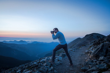 A Man Taking Pictures of Evening Mountains in Mountain Rainier NP