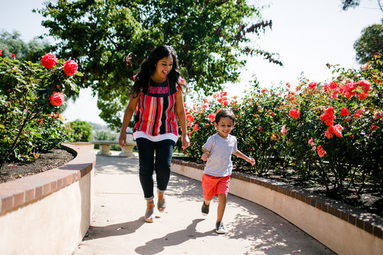 Mom Running and Playing with Son in Rose Garden