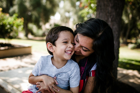 Mother and Autistic Son Laughing and Hugging
