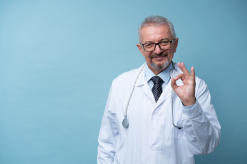 Portrait of a mature doctor standing in a hospital Stock Photo
