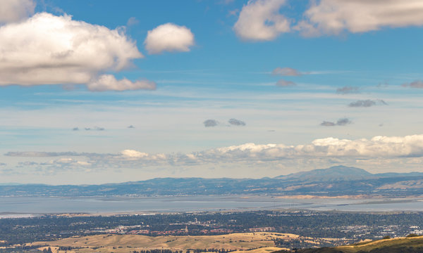 View Palo Alto and the San Francisco Bay including the Dumbarton Bridge, Stanford University, and the mountains of the East Bay.
