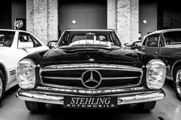 Sports cars Mercedes-Benz 280SL on May 01, 2019 in Berlin, Germany. Black and white.