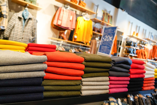 Dress store interior clothing shop sweater pullover colorful