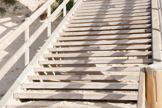 Empty staircase wooden stairs goes to sand sea in lacanau beach ocean