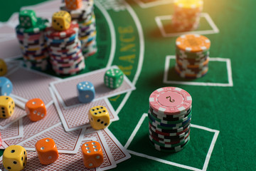 Casino equipment placed on the green floor for risky gambling for the people who want to get rich.