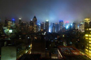 New York City at night during storm with fog, clouds and rain