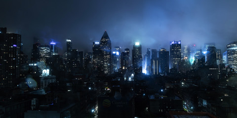 New York city at on a foggy night with lights glowing