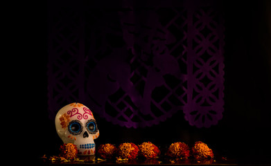 Wallpaper with sugar skull candle and cempasúchil flowers