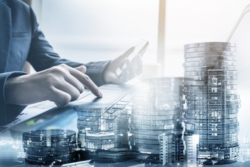double exposure of businessman working at office with step of coins and city night, financial and investment concept