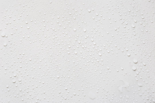 Raindrops on a grayish white background. Rainy season concept.