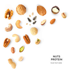 Creative layout made of walnuts, almonds, cashew, pistachio, peanuts, sunflowers and macadamia on white background. Flat lay. Food concept. Macro concept.