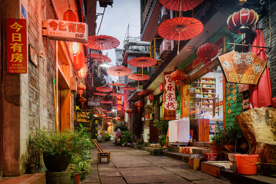 Street decorated with traditional Chinese umbrellas, Fenghuang