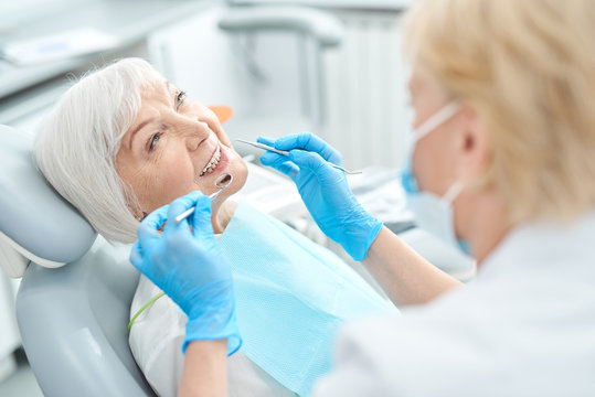Elderly patient treating her teeth at the dentist office