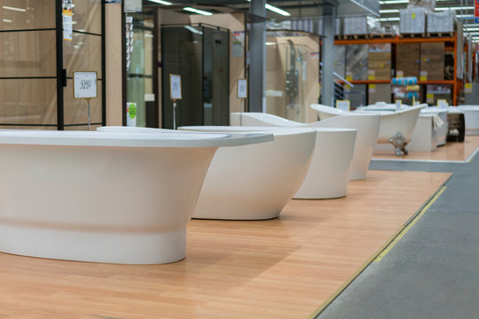 White bathtubs in a hardware store. The concept of choosing and installing bathtubs