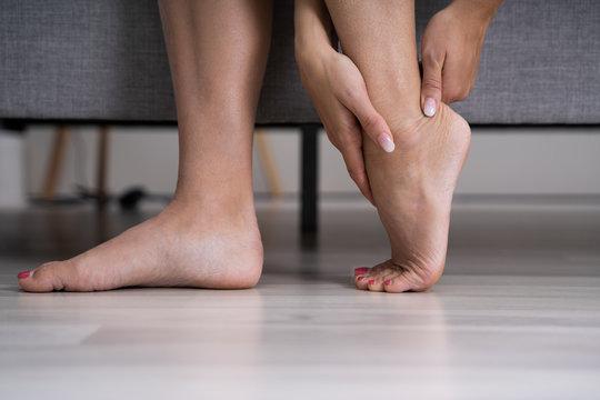 Woman Feeling Achilles Heel Pain