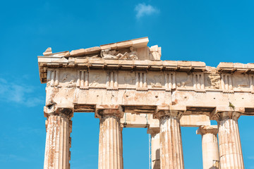 Fototapete - Parthenon temple closeup, Athens, Greece. It is a top landmark of Athens. Detail of facade with old relief. Ancient Greek ruins on sky background. Famous remains of classical Greek culture.