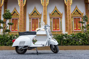Scooter retro scooter in the Thai temple