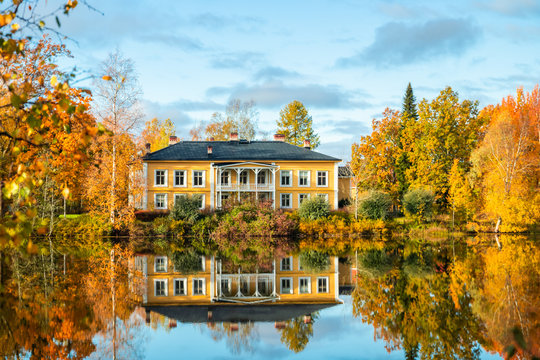 Kouvola, Finland - 8 October 2019: Autumn landscape with beautiful wooden Rabbelugn Manor - Takamaan Kartano. Wrede family house was built in 1820 on the river Kymijoki bank.