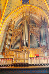 large organs of Saint Caprais Cathedral, in Agen, the world capital of dried prunes, in Occitania, in southwestern France - Free entrance