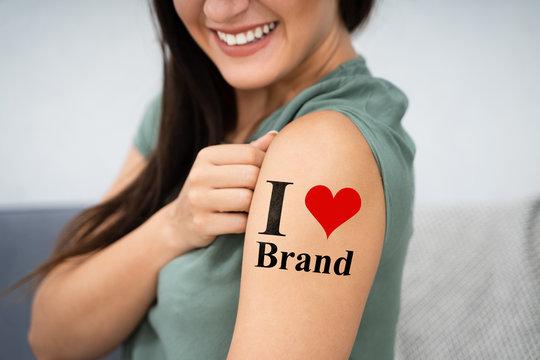 Woman Showing I Love Brand Tattoo