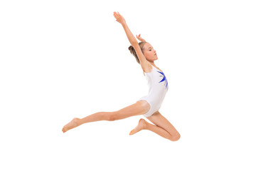 girl gymnast in white trico in full height performs in a white jump isolated on a white background