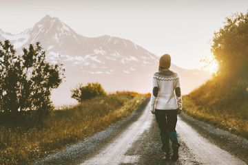 Woman walking alone on gravel road in mountains Travel lifestyle adventure vacations escape outdoor