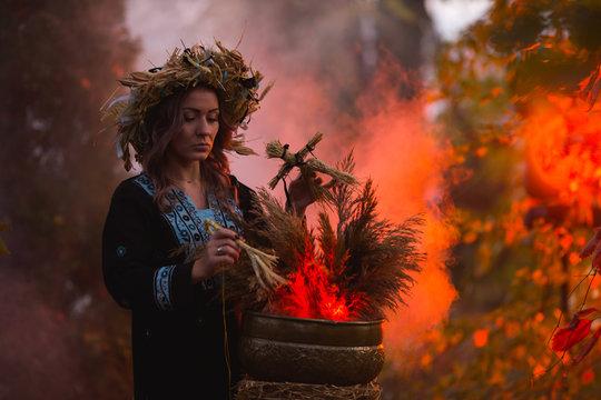 Woman sitting in burning pentagram circle, magic.
