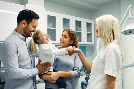 Family in dentist office