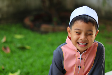 Portrait of muslim boy smiling happily. Child happy concept.