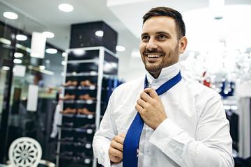 Smiling Young Man Enjoying Shopping
