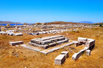 view of the temple of Apollon in the archaeological city of Delos Island, near Mykonos, beautiful Cycladic island, in the heart of the Aegean Sea