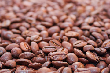 roasted coffee beans background. arabica and robusta mix. shallow depth of field