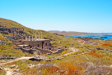 view of the temple of Poseidon in the archaeological city of Delos Island, near Mykonos, beautiful Cycladic island, in the heart of the Aegean Sea