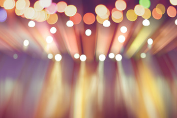 blurred lights on stage, abstract image of colourful lighting, background party blur celebration concept.