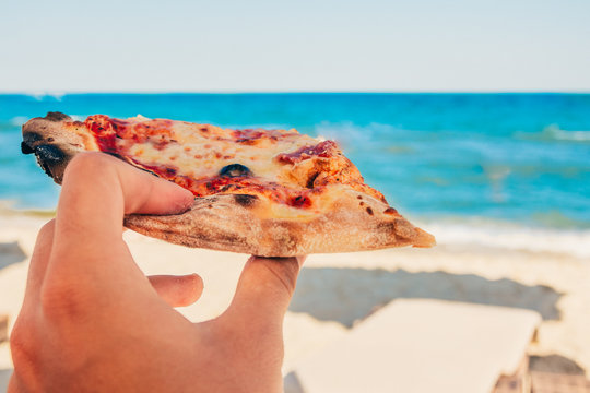 eating pizza at the beach