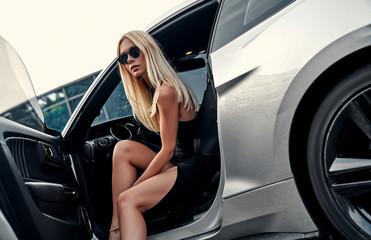 Woman in sport car