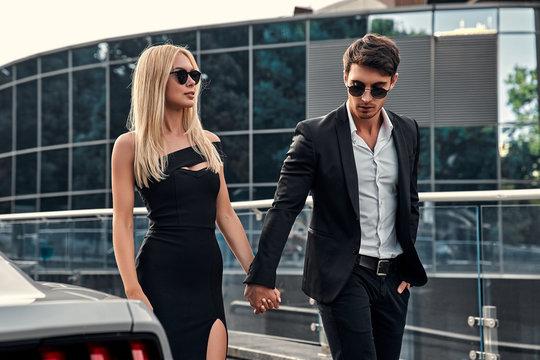 Couple near car