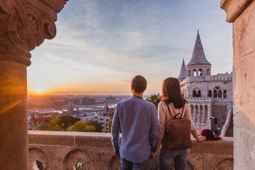 Foto auf Acrylglas Budapest Young couple enjoy the view from the point from Fisherman Bastion in Budapest during sunrise.