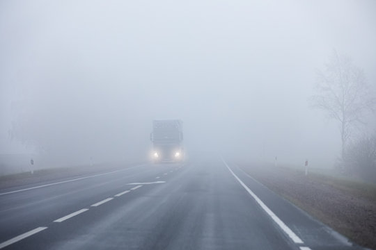 Truck on the road in the fog