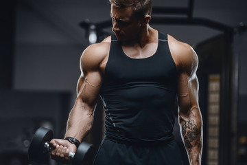Keuken foto achterwand Fitness Handsome strong athletic men pumping up muscles workout fitness and bodybuilding concept background - muscular bodybuilder fitness men doing arms abs back exercises in gym naked torso.
