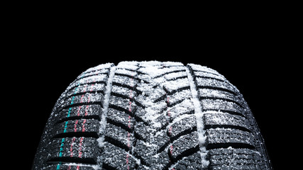 Winter Car tires with snow close-up wheel profile structure on black background