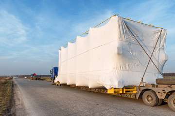 Truck with large oversized cargo on rural road - fototapety na wymiar