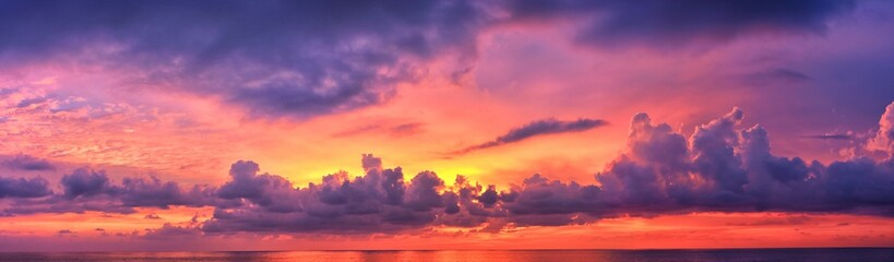 Poster Beach Phuket beach sunset, colorful cloudy twilight sky reflecting on the sand gazing at the Indian Ocean, Thailand, Asia.