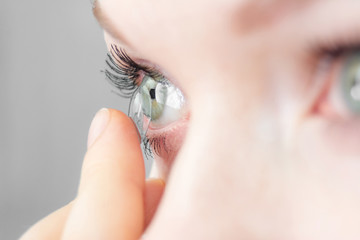 girl wearing soft contact lenses close-up macro