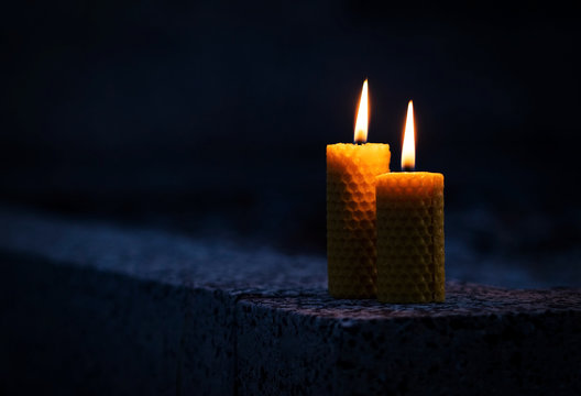 Two candles with beeswax on the monument