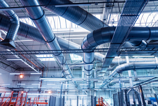 Air conditioning of buildings. Background of ventilation pipes. Laying of engineering networks.